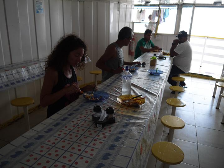 Alya having breakfast in the 'diner area'. Amazon boat trip