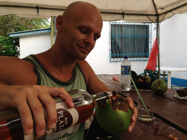 Nightlife on the island. Drinking some local rum out coconuts. Spiking coconuts with some local rum.Spiking coconuts with some local rum. Little Corn Island Travel guide.