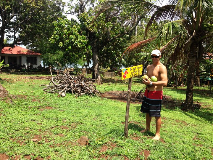 Picking coconuts around the island. Activities on Little Corn. Alya picking up some mangos on the way home. Little Corn island travel guide.