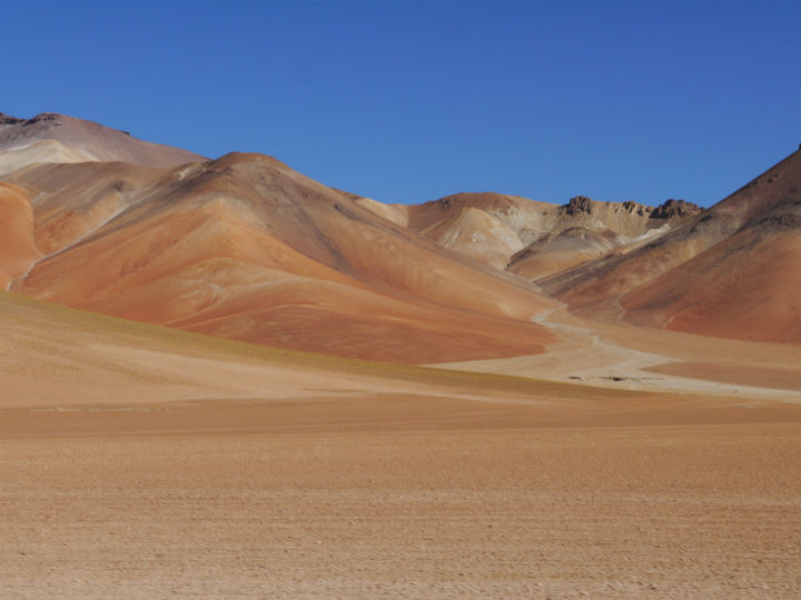 Amazing multi coloured mountains surounding the salt flats.