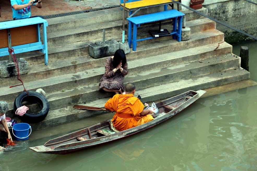 Buddhist monk collecting donation, Amphawa. Floating markets Amphawa vs Damnoen Saduak