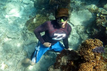 Diving Perhentian Campbell snorkeling with a cap for the sun.