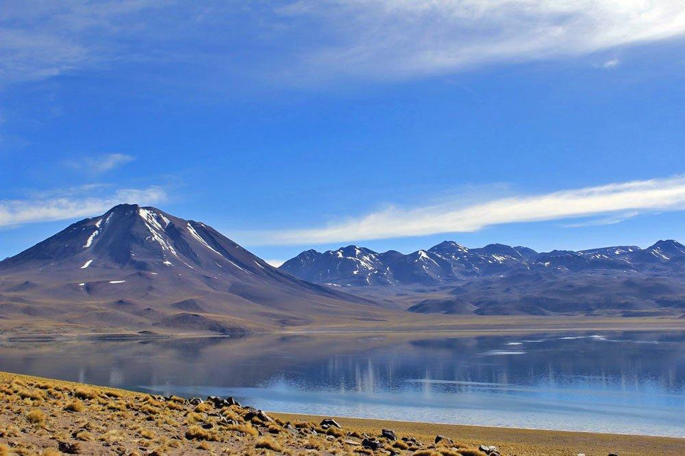 Crystal clear blue water of the Miscanti lake, Lagunas Altiplanicas, Atacama