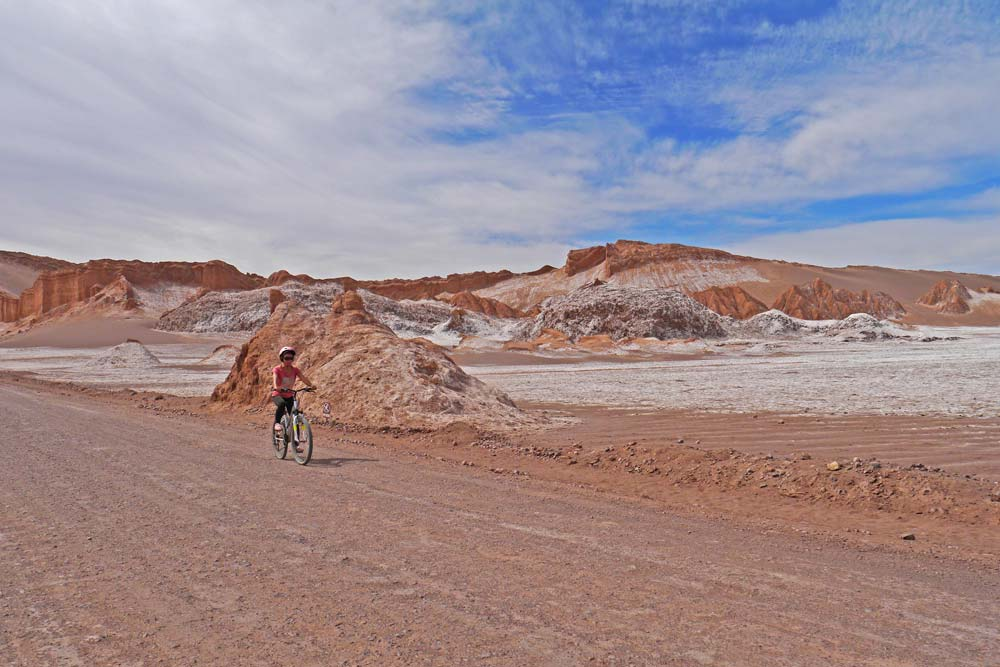 Alya cycling through the desert in the Moon Valley, Atacama.