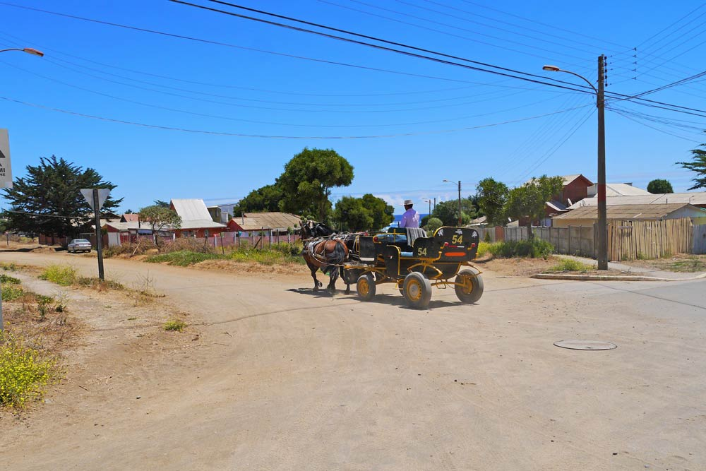 Gravel streets with a horse cart in Pichilemu, Chile