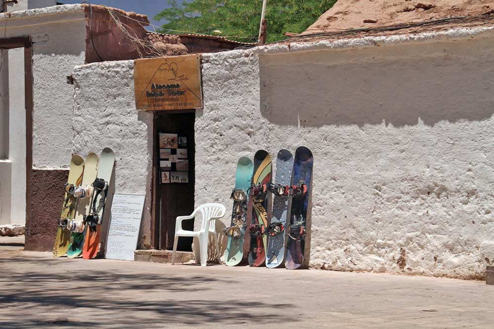 Many sand boards next to a shop in the Atacama desert, one of the coolest things to do for adventure lovers