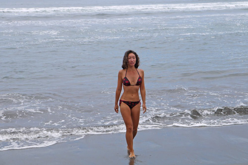 Alya walking out of the cold water to the beach, Pichilemu