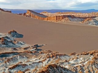 Sand dunes and orange rocks. The scenery in the Moon Valley, one of the must-visit places in the Atacama