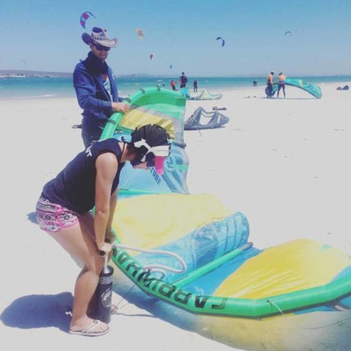 Alya pumping the kite, kiteboarding Langebaan.
