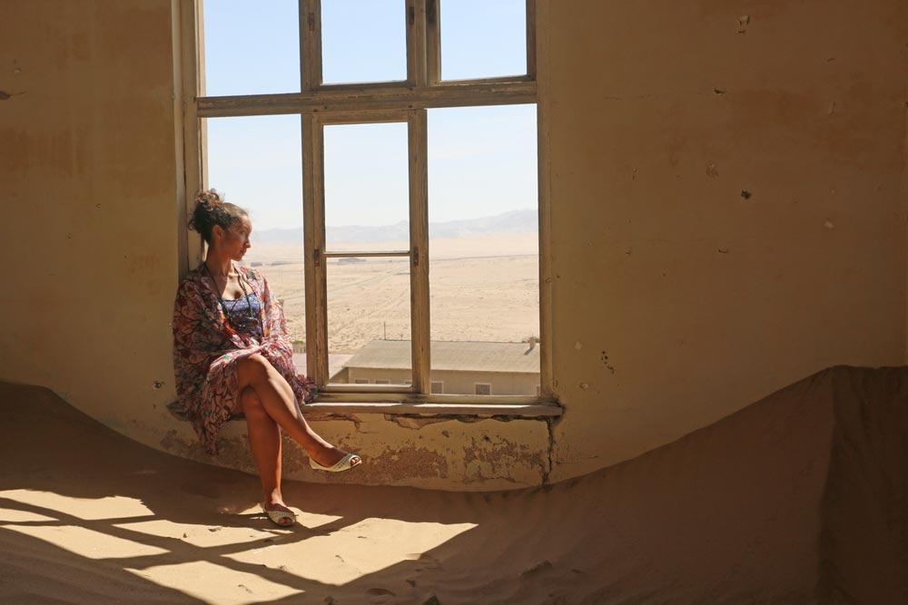 Alya visiting Kolmanskop, one of the main things to do in Luderitz