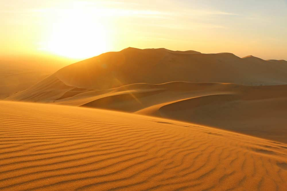 Sunset from Dune 7 is a must-do on the Namibia to Vic Falls trip