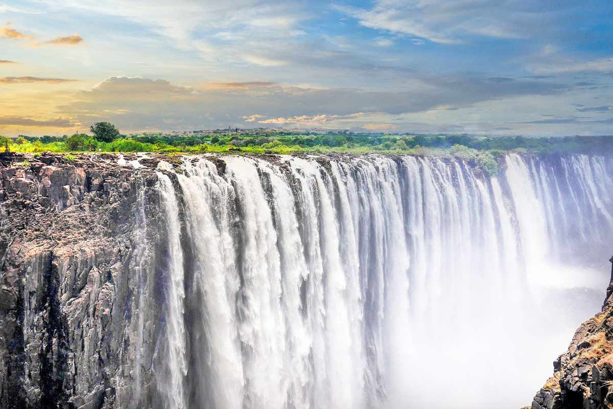 Victoria Falls in the rainy season at the sunset