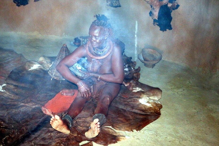 "Traditional Himba ""shower"". Native people of Namibia"