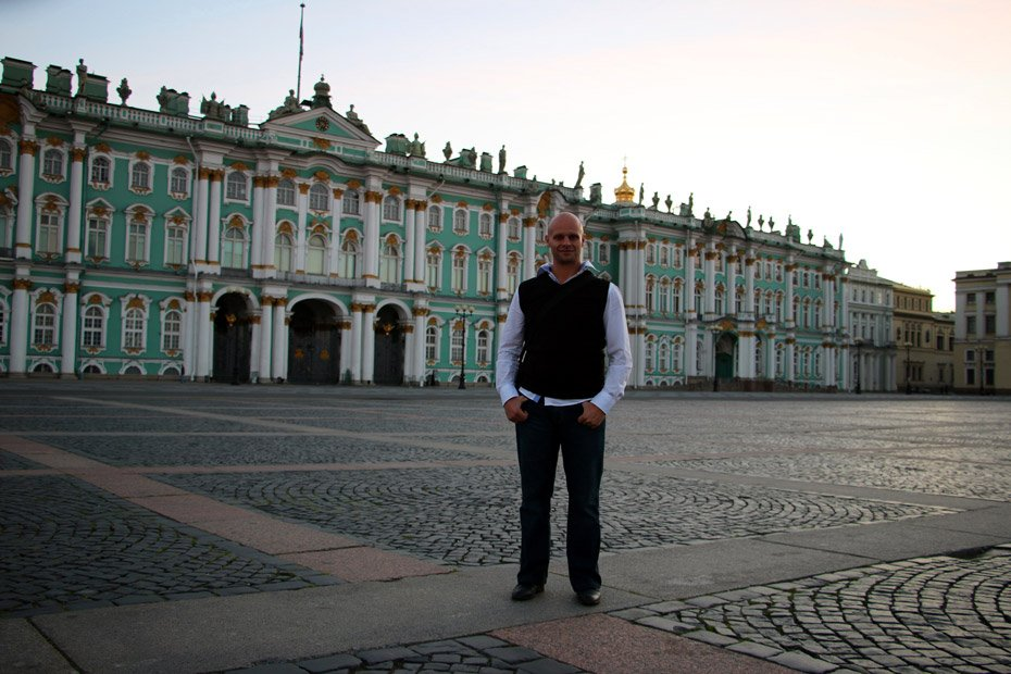 Campbell at 4am on Palace Square with Hermitage on the background. St.Petersburg city guide.