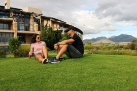 Stingy Nomads, Campbell and Alya, relaxing on the golf course at Arabella hotel.