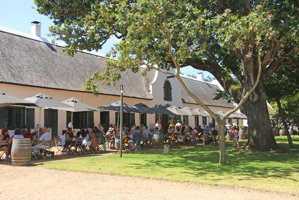 An open-air restaurant at Groot Constantia a must visit area for wine lovers