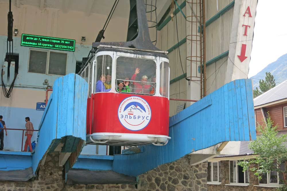A cable car with climbers heading to the top of Mt.Elbrus