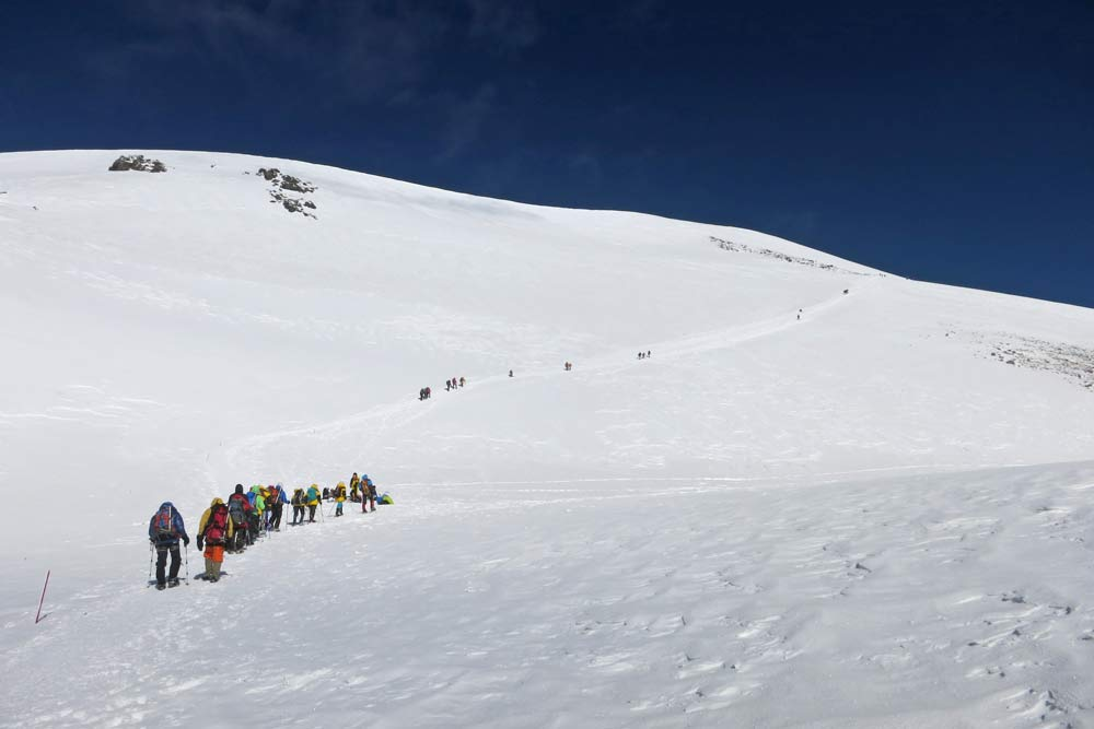 A line of climbers heading to the top of Elbrus