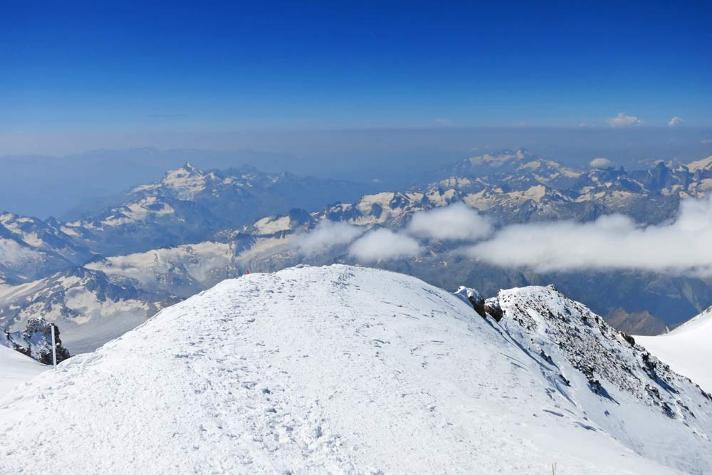 A view of snowy peaks and mountains from Elbrus