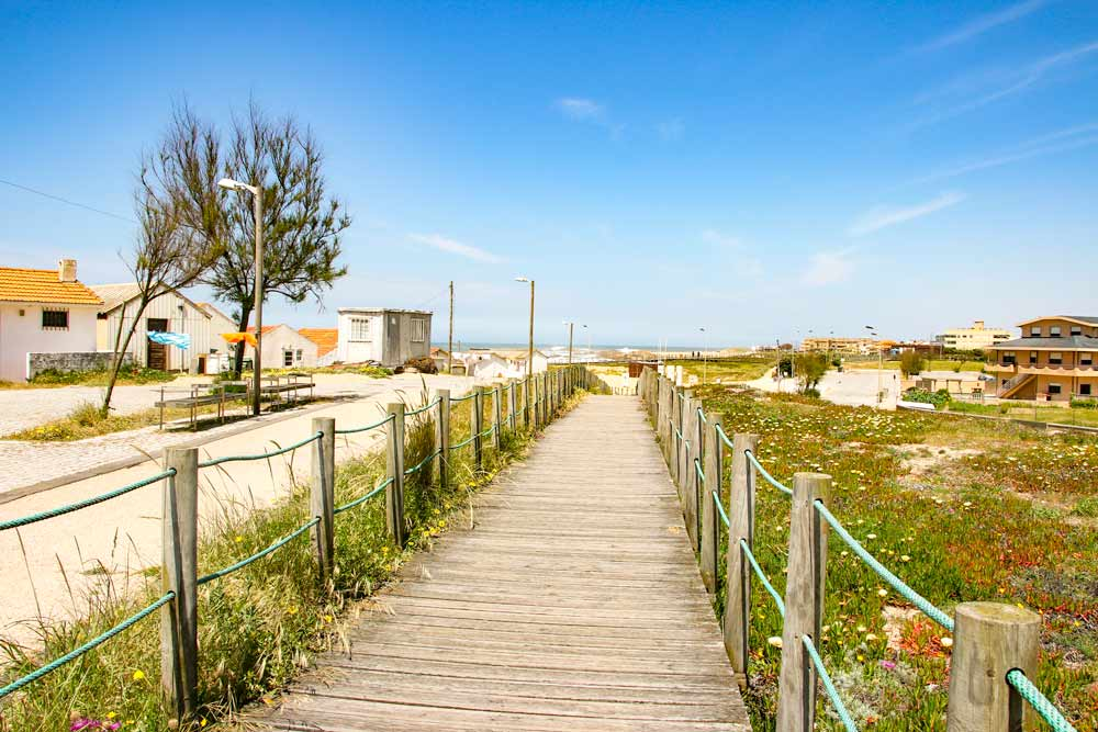 Boardwalks along the beach on the way from Porto to Labruge