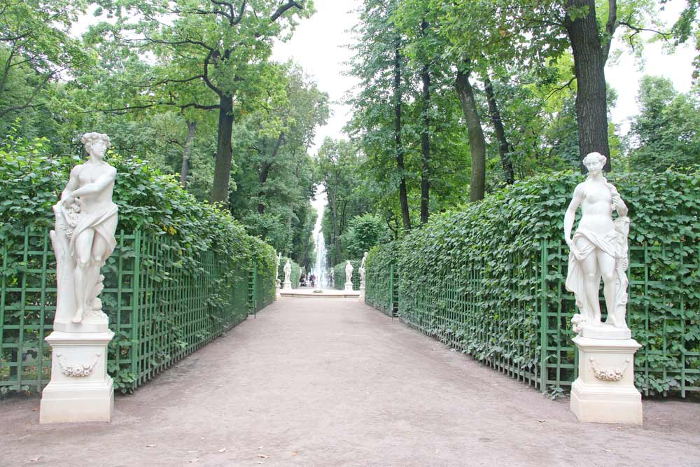 One of the alleys with fountains and sculptures in the Summer Garden of Saint Petersburg