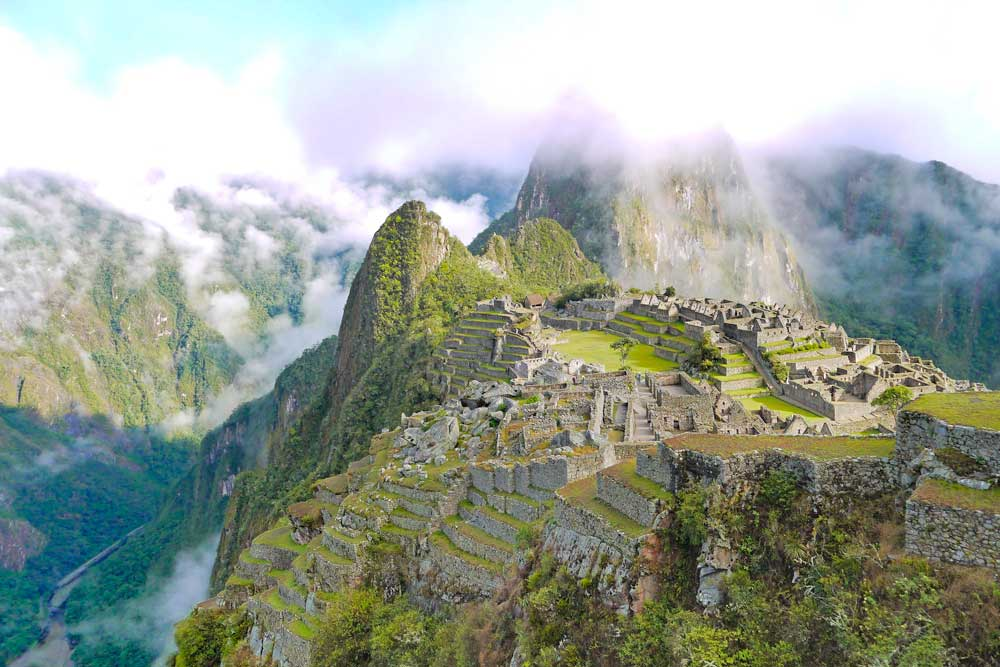 Machu Picchu ruins with Huaynapicchu Mountain on the background