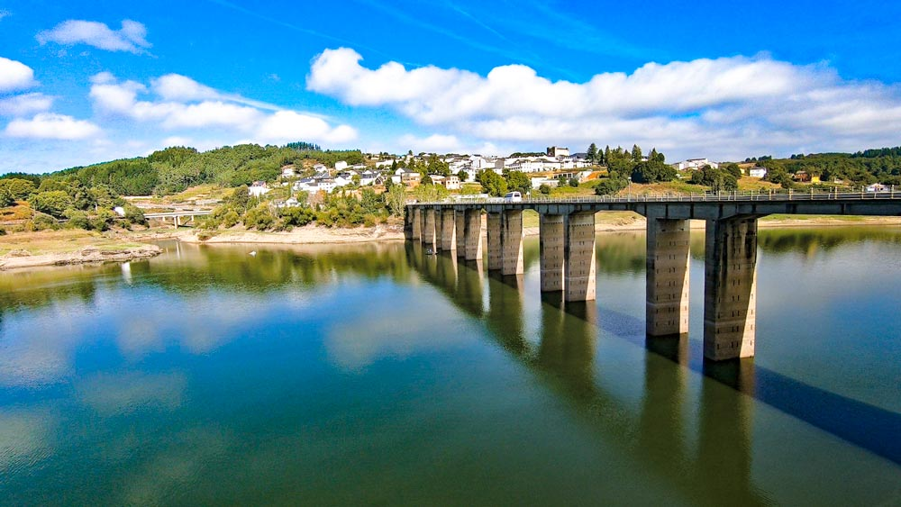 A bridge over the river and Portomarin, the first stop on the Camino from Sarria