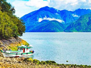 A small colorful boat at Caleta Gonzalo in Pumalin Park
