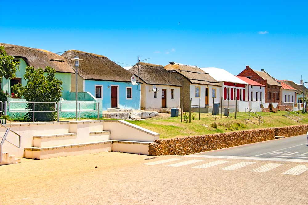 Colorful houses in Elim on the scenic drive to Cape Agulhas