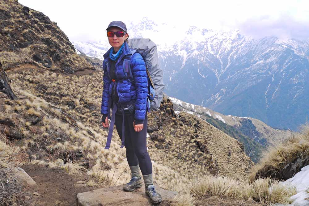 Alya with a big backpack on the way up on the Mardi Himal trek
