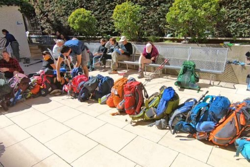 Pilgrims queuing their backpacks at a public albergue on the Camino