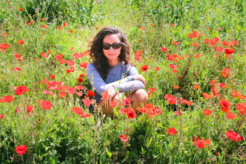 Alya in the middle of the flower field in Central Portugal