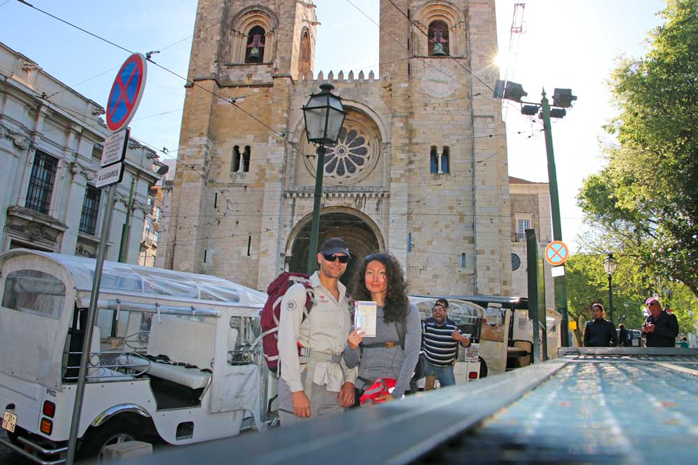 Campbell and Alya standing in front of the Se Cathedral in Lisbon, the beginning of the pilgrimage