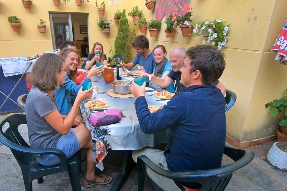 Pilgrims having dinner at an albergue on the Camino Frances