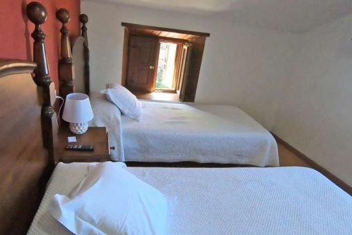 A small twin room with two single beds