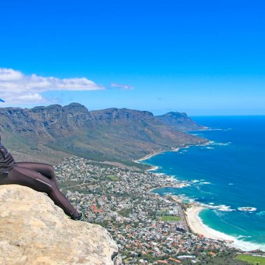 Alya on the edge of the cliff with the stunning view of Cape Town