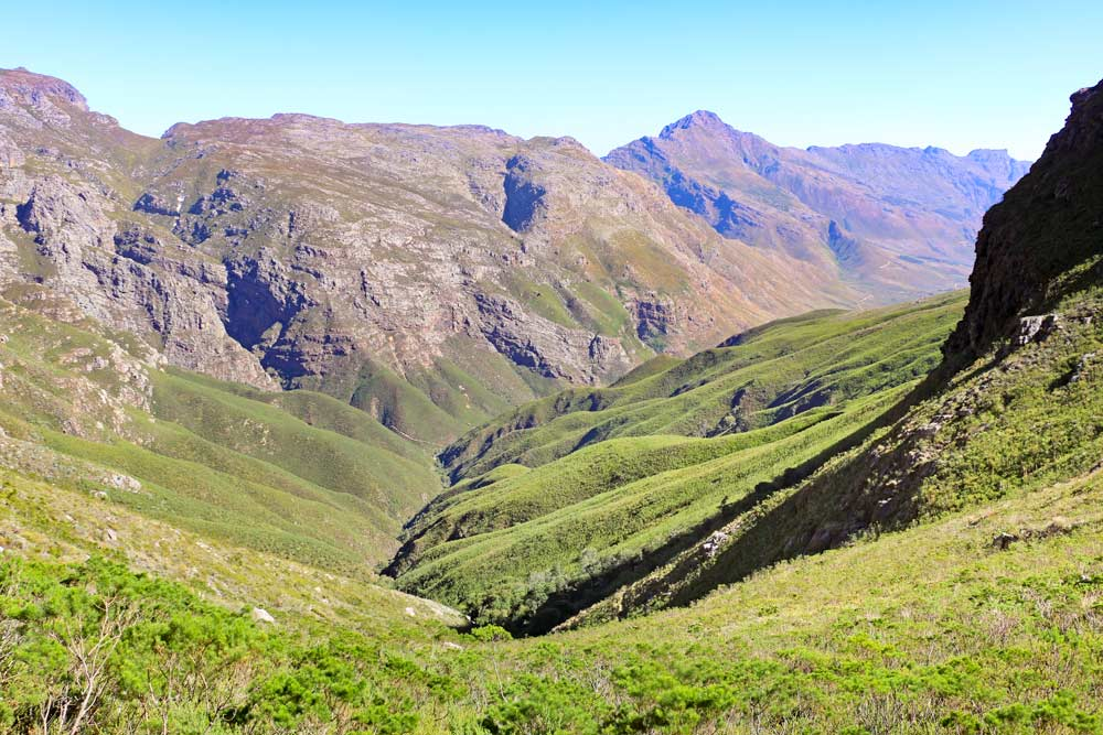 Green mountains and rocky peaks in the Jonkershoek Nature Reserve, a great place for a day trip from Cape Town