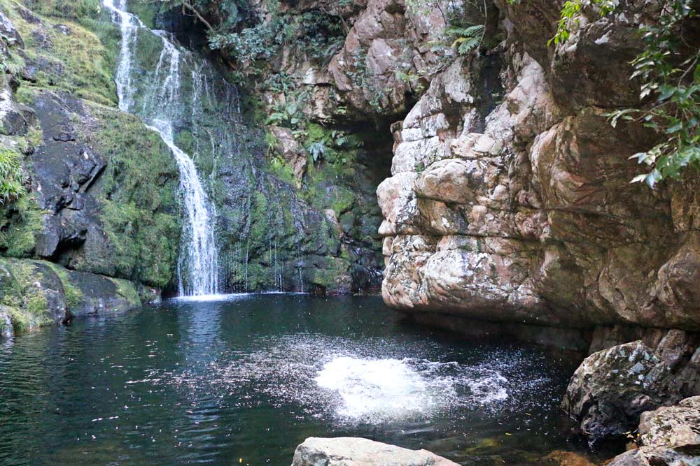 A natural pool with a small waterfall on the Krom River trail near Rawsonville