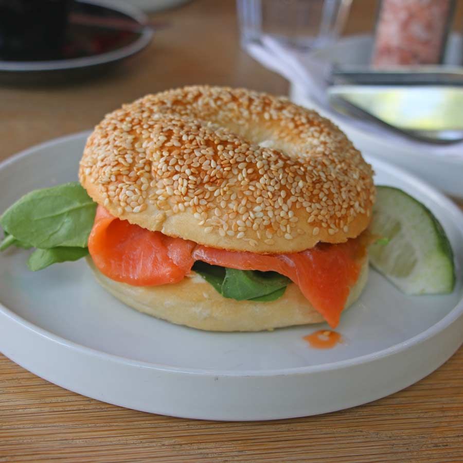 A bagel with salmon and greens at Bootlegger Coffee Shop in Cape Town