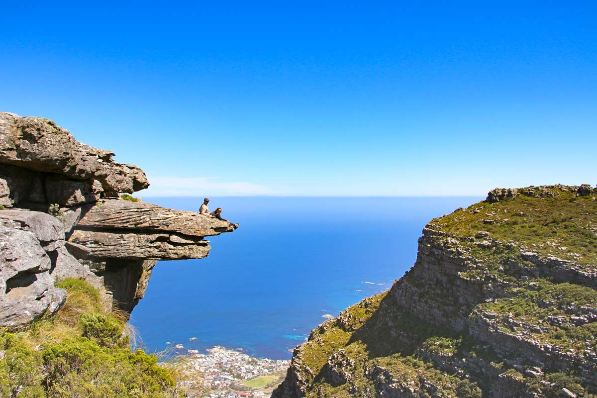 Stingy Nomads on the edge of the Diving Board, a cliff on the top of Table Mountain