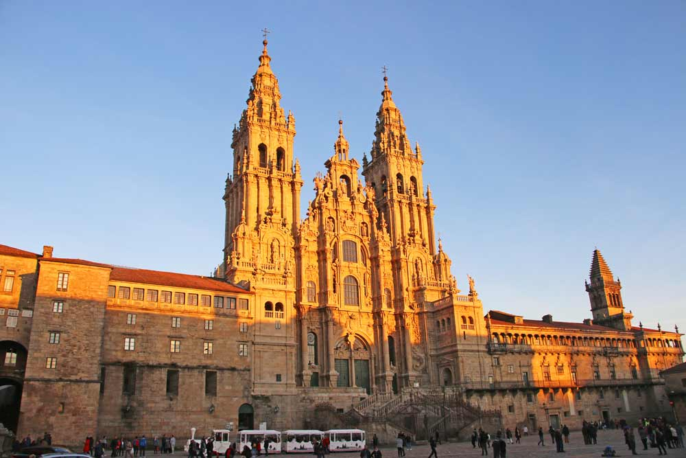 The front facade of the Cathedral in Santiago de Compostela at sundown