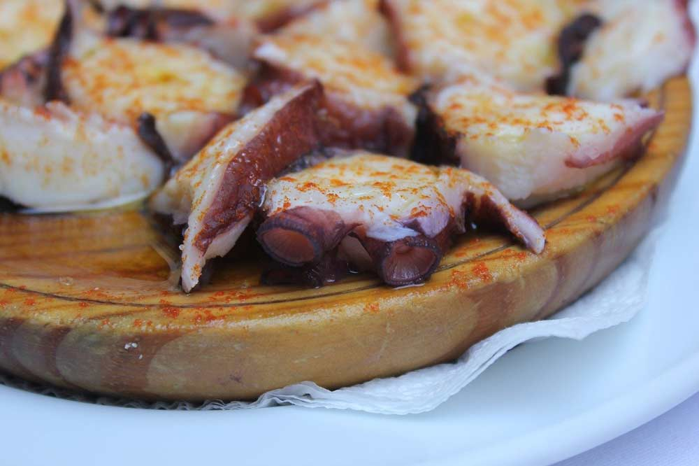 Eating pulpo a la Gallega is one of the things to do in Santiago de Compostela