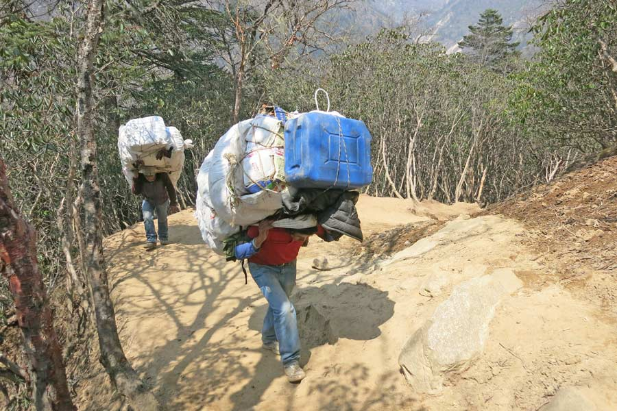 Porters carrying equipment to Everest Base Camp